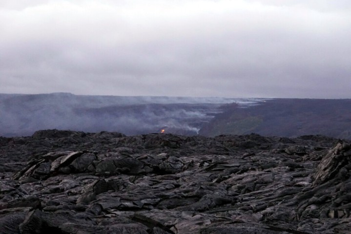 Lava flowing downhill to the ocean